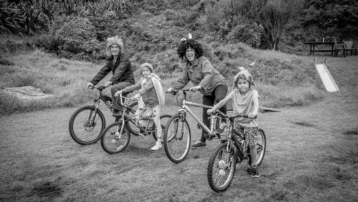 "Scott, Alice, Khaz and Henry: ""Lockdown for us is whanau, kai and kindness, sun-sets and slowing down, biking and budgeting, contemplating what we don't want to return to, community, conspiracies, queues, frustration and patience, appreciation and love."""